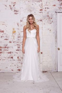 The WILD HEARTS Collection - Genevieve Skirt Overlay - Silk georgette overlay with delicate hip draping from center front to center back. Can be styled with a variety of gowns. Completed with a hook and eye waistband closure.