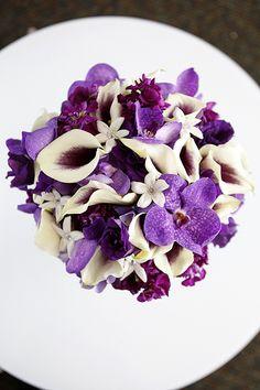 Picasso mini callas, purple vanda orchids, purple stock and stephanotis