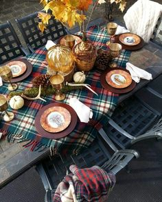 Plad blanket instead of a traditional tablecloth to cozy up your outdoor dinner