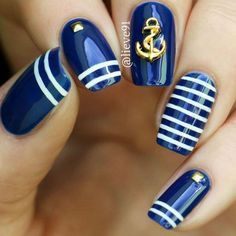 Short Blue Nails With Stripes And Anchors Art #stripednails #anchorsart Discover classy and fab, cute and easy, matte and glitter unique nail designs for short nails that will go for summer, winter, spring, and fal. #shortnails #naildesigns #nailart