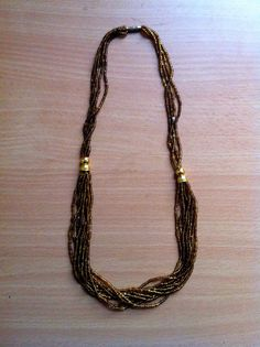 Handmade beaded necklace, gold. 100% of sales go to support the Youth Education Network of Kenya - www.yenkenya.org