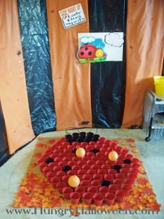 Ladybug or Pumpkin balloon game:  Board with plastic cups attached. Throw a balloon. If it lands on a black cup get a big prize, anywhere else a small prize.