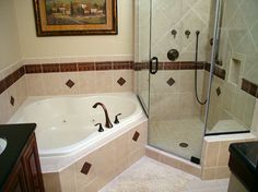 Corner whirlpool tub and seperate glassed-in shower make the most of limited bathroom space.