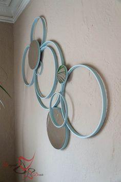 Awesome wall art using embroidery hoops.