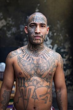 Adam Hinton has photographed the most dangerous places in the world, none more so than El Salvador, where the MS-13 gang welcomed him gladly into their community and their private prison