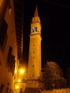 The church steeple in Fonzaso, illuminated, at night.