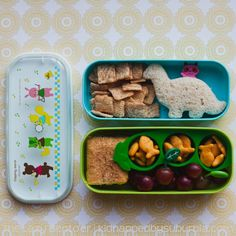lunch: peanut butter + nutella sandwich, cinnamon toast crunch, goldfish in a pea-shaped silicone cup, grapes with leaf picks