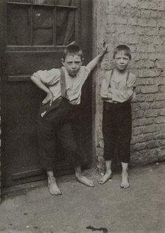 "In the early 1900s, Spitalfields was regarded as one of the worst areas in London. People of higher upbringing were said to have avoided this area, where its residents lived in extreme poverty and criminals lurked. However, photographer Horace Warner braved the alleys of this neighborhood and took arresting images of its youth, who he had called the ""Spitalfields nippers."""