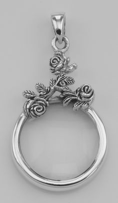 Antique style rose magnifying glass pendant 5x sterling silver this sterling silver magnifying glass pendant with rose design measures 1 inches h x 1 inch w aloadofball Image collections