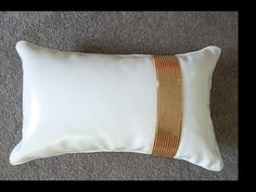 Copper Glomesh on shiny faux leather cushion, tres chic.