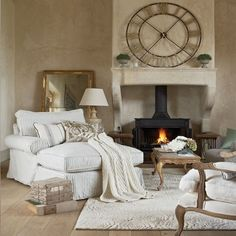Cosy French-style living room. mmmm perfect look for cold winter nights