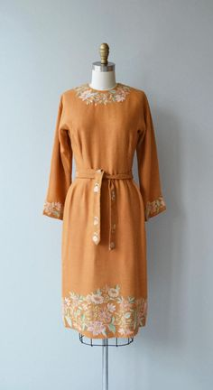 Vintage 1950s mustard wool dress with exquisite floral embroidery at the neckline, sleeves, belt and hem. Fitted waist with metal zipper at the back of the neck and side of the waist. --- M E A S U R E M E N T S --- fits like: small bust: 35 waist: 26-27 hip: free length: 41 brand/maker: n/a condition: excellent to ensure a good fit, please read the sizing guide: http://www.etsy.com/shop/DearGolden/policy ✩ layaway is available for this item ✩ more vinta...
