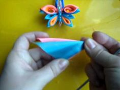 Video- kanzashi butterfly tutorial - she is speaking Russian but the demonstration is easy to follow.