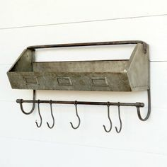 -Crafted from galvanized metal-Industrial-style metal wall bin with hang bar-Hooks can slide to adjust, includes 5 hooks-Dimensions: 24 Farmhouse Style Decorating, Farmhouse Decor, Interior Decorating, Farmhouse Ideas, Decorating Ideas, Metal Storage Bins, Industrial Bar Stools, Industrial Style, Hanging Bar