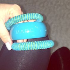 Marc Jacobs bangle set One thick Marc by Marc Jacob bangle and two costume jewelry bangles to match (no additional charge for two costume jewelry bangles). In great condition Marc by Marc Jacobs Jewelry Bracelets
