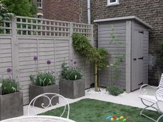 Patio garden with small wisteria and painted sheds shed design # . Patio garden with small wisteria and painted sheds shed design shed diy shed Small Garden With Shed, Small Garden Fence, Back Garden Design, Backyard Ideas For Small Yards, Backyard Garden Design, Backyard Landscaping, Small Garden Ideas Artificial Grass, Garden Ideas Near Fence, New Build Garden Ideas