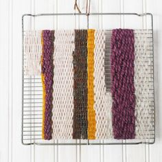 Weave some wall art with a vintage baking rack and yarn!