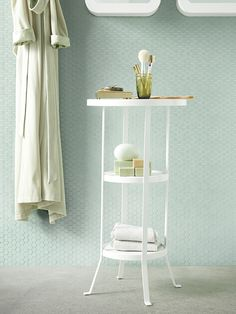 The subtle raised edge around the IKEA GUNNERN pedestal tabletop helps keep things from sliding off - perfect for storing items in your bathroom, living room or anywhere else you have small items on display!