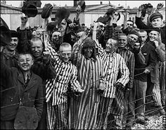 Prisoners in Dachau cheer at the sight of Americans