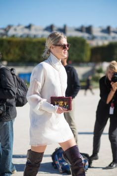 Over the knee snakeskin boots can give even the prettiest white dress some extra edge. See all the best street style from Paris fashion week: