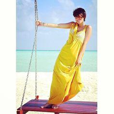 Giulia Malavasi in our bright yellow long beach dress.