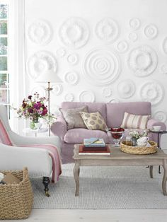 After: Crisp Style - The secret to this subtle yet super-stylish wall treatment? Ceiling medallions! We installed the ones shown here (from $12.28; homedepot.com) in a single day using adhesive caulk. A Belgian-linen slipcover by Bemz updates a standard Ikea sofa—and delivers a soft dose of color.  Read more: Living Room Makeovers - Ideas for Living Room Makeovers - Country Living