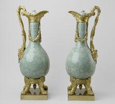 Located 2015 in the Picture Gallery of Buckingham Palace, London, UK. 1 of 2 pins of Pair of bottle shape vases are of celadon porcelain made in Jingdezhen, Jiangxi, China. Vases enameled in sea green & decorated with butterflies & trailing vines. Gilt bronze mounts as ewers, with river god heads, swan necks, the badge of the French Order of the St Esprit & claw feet. Bought by King George IV (1762-1830) UK in 1827, Uncle of Queen Victoria (1819-1901) UK.