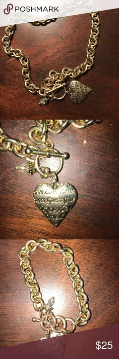 Guess choker and bracelet Guess choker and bracelet bundle some tarnish but doesn't take away from the bracelet still looks stylish😊 gold with black writing on heart Guess Jewelry Necklaces