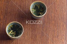 close-up shot of tea cups. - Detailed shot of tea cups on wooden table.