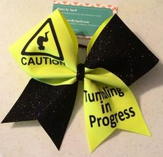 Bows by April - Caution Tumbling in Progress Black and Neon Yellow Glitter Cheer Bow, $16.00 (http://www.bowsbyapril.com/caution-tumbling-in-progress-black-and-neon-yellow-glitter-cheer-bow/)