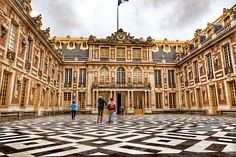 I shot this photograph at the Palace of Versailles in France. Question: if you were a French citizen in the 17th century, and your king built himself a palace with $300 billion of your tax dollars, what would you do? The French revolted. Come see and learn more: http://www.theroamingboomers.com/marble-courtyard-palace-of-versailles/