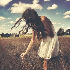 sometimes all I want to do us wander through a field barefoot in a white dress under an open sky with the wind blowing my hair and the sun in my eyes.