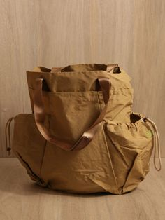 Hobo men's All Weather Fabric Waist Tote Bag from S/S 11 collection in beige.