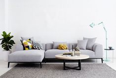 The Danielle Chaise Sofa, and Pyrmont Round Wooden American Elm Coffee Table. Also featured here with an Armadillo & Co Sierra Weave Rug. #sofa #lounge #roundwoodencoffeetable #rug
