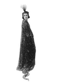 silent film star Alla Nazimova spiderweb cloak and headdress . http://www.youtube.com/watch?v=Bm1v98K8K4E