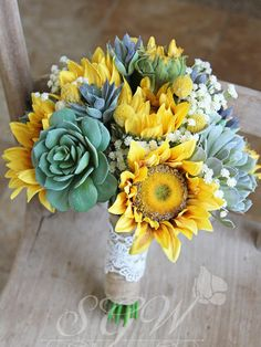 Sunflowers symbolize loyalty and trust - you can see why they are a popular flower when it comes to weddings. This lovely bouquet features