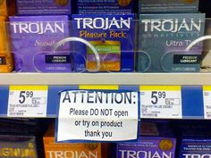 A supermarket displaying boxes of Trojan condoms on its shelves is apparently taking no chances with its eager customers. A sticker reads: 'Attention: Please do not open or try on the product'