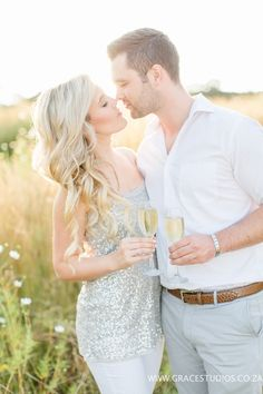 Include champagne in your engagement photos