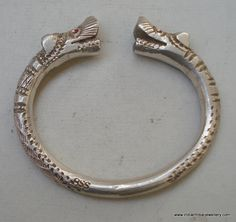 Vintage Antique collectible solid tribal old silver makara Heads men;s Bracelet / Bangle (Kara) from Rajasthan India. Made of solid silver and then engraved design on it, Worn by tribal people of Rajasthan. These bracelet are symbol of power and luck.