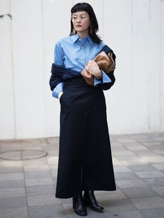 This maxi skirt and button-down pairing is made inimitably chic with an off-the-shoulder jacket, and black leather ankle boots pare down the entire ensemble