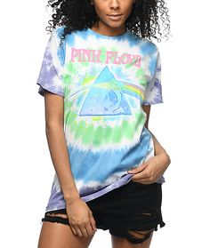 You'll want to make daisy chains and chill out when you're wearing the Pink Floyd Tie Dye T-Shirt. This classic tee features Pink Floyd's 1973 Dark Side of the Moon album artwork centered over a green and blue tie dye pattern.