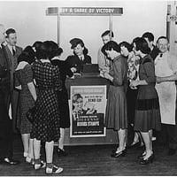 Victory Begins at Home - World War II Posters  Woman at Booth Selling War Bonds