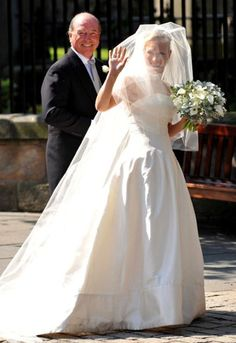 Zara Phillips as she enters the church with her father, Capt. Mark Phillips