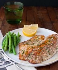 Sautéed Tilapia with Garlic Herb Butter Sauce | tamingofthespoon.com
