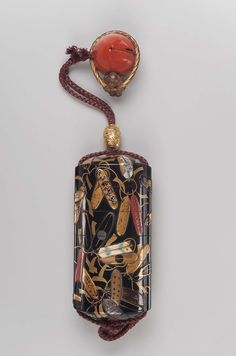 Netsuke in the form of a monkey with a giant peach |Ojime with dragon and wave design 19th century