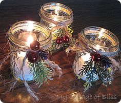 Jelly jars w/little sprig of greenery, wrapped jute around the neck of the jar two or three times, attached red balls and pine cones in the area of the knot with hot glue.  Epson salt and candle below the jar rim