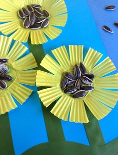 These Cupcake Liner Sunflowers are a fun craft for kids.