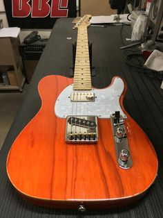 G&L Musical Instruments added 3 new photos. Here's an ASAT Classic Bluesboy in Clear Orange over swamp ash, wood binding, pearl guard, number 1A profile maple neck with Light Tint Satin finish