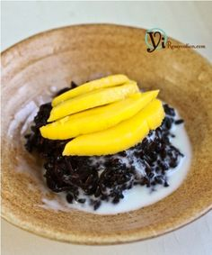 Explore this delicious Black Rice with Mango in Coconut Sauce dessert. It's made of healthy black rice and perfect for the summer.
