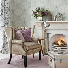 Modern lilac and silver living room. Not the wall paper but the rest.........love it.